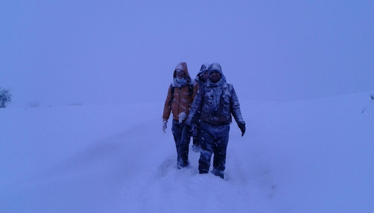 Tariq and his friends, and they are walking on the snow